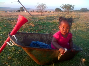 "My sweet little niece Anati hanging out in Thabiso's ""car."" (Note the awesome steering wheel)"